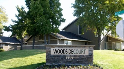 """Woodside Court property and signage reading """"Woodside Court 555"""""""