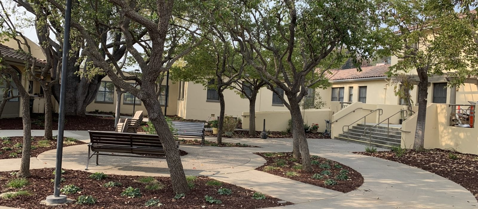 Courtyard with trees and benches at Wheeler Manor property