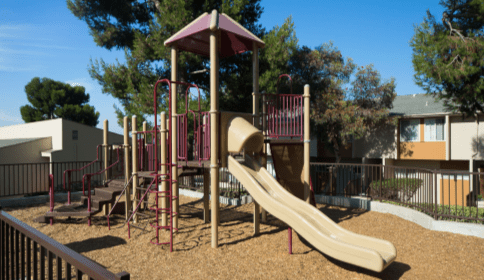 Playground with property in background at Vista Terrace Hills property