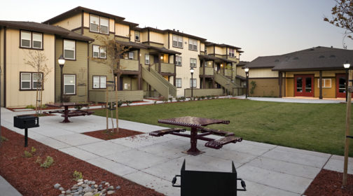 Walker Landing property with courtyard, lawn, and picnic tables