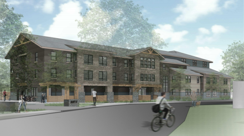 photo portrays the proposed Ruby Street Apartments, a street view. people on bicycles and walking along the pathway next to the building.